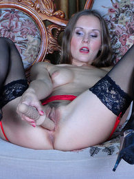 Smashing lady in red slowly rides up her dress before stockinged dildo play pictures at kilosex.com