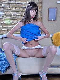 Lovely girl encases her mile-long legs in glamorous white gartered nylons pictures at relaxxx.net