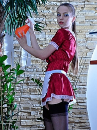 Hot maid in a red uniform and black FF nylons pleasuring her itching pussy pictures at adspics.com