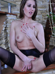 Long-legged teaser fingering in black suspender stockings and fuck-me-heels pictures