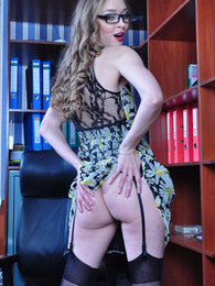 Smashing upskirt secretary strips to classy black stockings in the office pictures at kilosex.com