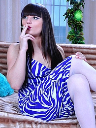 White-stockinged smoker produces a rubber long dong ready to get naughty pictures at dailyadult.info