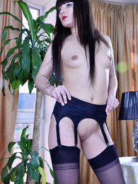 Upskirt teaser in black seam-n-heel stockings exposes her round ass cheeks pictures