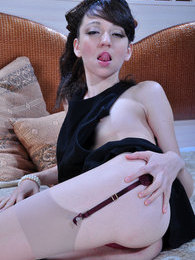 All dolled-up brunette in barely visible nylons and raunchy stiletto heels pictures at kilosex.com
