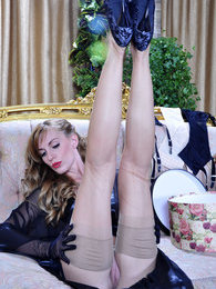 Gorgeous babe tries on retro style gloves with classy nylons and suspenders pictures at kilosex.com