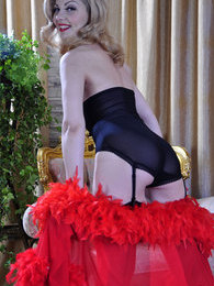 Dazzling variety show girl changing out of her smashing red-n-black nylons pictures