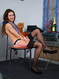 Leggy upskirt flasher naughtily bends down and strips to her black nylons pictures at freekilopics.com