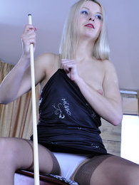 Hot blonde clad in shiny tan nylons flashes her behind in the billiard room pictures