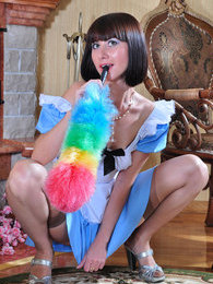 Playful chick in classy gartered nylons changes into a pretty maid uniform pictures at kilogirls.com