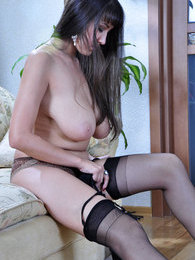 Bigtitted brunette adjust classy black gartered nylons on her shapely legs pictures at sgirls.net