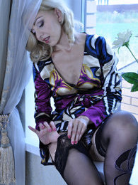 Dolled-up blonde boasting her cute lingerie and lush patterned lacy nylons pictures at find-best-babes.com