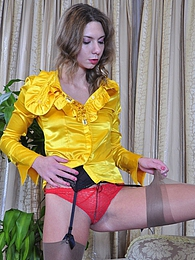 Lean babe wearing her ultra sheer nylons with bright red-and-yellow attire pictures at find-best-panties.com