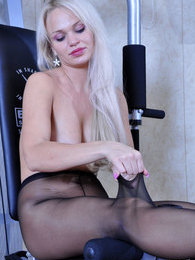 Sporty platinum blonde in black sheer-to-waist pantyhose exercising topless pictures at lingerie-mania.com