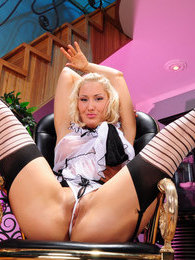 Cutie gets into playful mood changing her black stockings for striped ones pictures at kilovideos.com