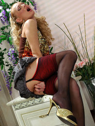 Blondie in contrast top stockings playfully posing in front of the mirror pictures at kilosex.com