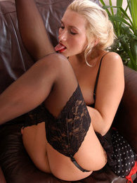French maid in red-n-black uniform and black stockings pleasuring her muff pictures at adspics.com