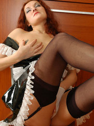Kinky French maid in classy stockings parting her pussy lips with panties pictures