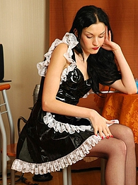 Hot maid putting on her barely black back seam stockings right on the table pictures