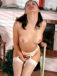 Glamour chick in glossy white stockings going down for wild dildo session pictures at kilosex.com