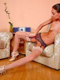 Naughty chick having time for posing in her silky full-fashioned stockings pictures