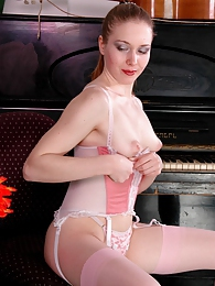 Kinky chick in pink stockings playing with her pussy instead of the piano pics