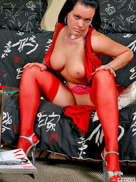 Stunning beauty posing sexy in her red nighty with matching red stockings pictures at lingerie-mania.com