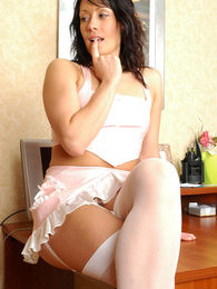 Tempting maid in a skimpy uniform with classy white stockings pleasing pink pictures