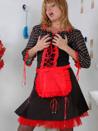 Dazzling French maid in red-n-black uniform with matching black lacy nylons pictures at lingerie-mania.com