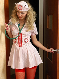 Pretty nurse in sexy red fishnets answering a call of a lez chick in heat pictures at lingerie-mania.com