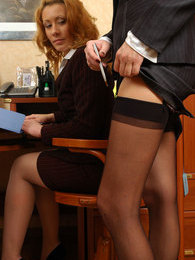 Two chicks in business suits flash stockinged legs while having box lunch pictures at lingerie-mania.com