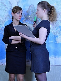 Two sexy teachers exchange sensual lesbian kisses before using a strapon pictures at kilogirls.com