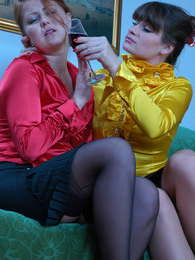 Dressed-up sapphic gals savour lesbian evening with wine and pussy-fondling pictures