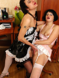 Two uniformed French maids tongue kissing and licking clean their pussies pictures