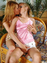 Extremely seductive chicks satisfying their lesbian lust right on the couch pictures at sgirls.net