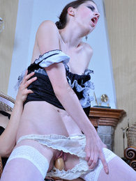 Hot gal in maid uniform gets spread on the table by a strap-on armed lezzie pictures