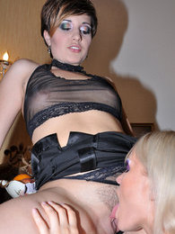 Sultry blonde pushes a brunette's thong aside aching to taste her wet muff pictures at lingerie-mania.com