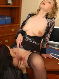Stockinged lezzies tenderly kissing and muff-diving in office all-girl play pictures at lingerie-mania.com