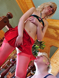 Blonde cock-teaser in raunchy red stockings gets punished with a raw fuck pictures at freekiloporn.com