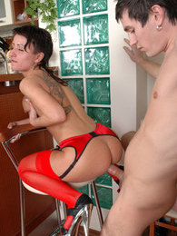 Sweltering babe in red stockings teasing the hell out of a sex-crazy stud pictures at kilogirls.com