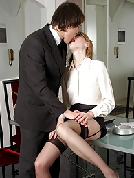 Freaky secretary in black stockings launching into fucking action on table pictures at freekiloporn.com