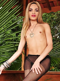 Heated tranny wanking off her stiff stick with her control top pantyhose pictures