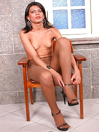 Raunchy shemale getting her nut off on her shiny sheer-to-waist pantyhose pictures at freekiloporn.com