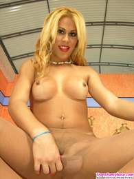 Sizzling hot blonde shemale unloading her cock on tan pantyhose by the pool pictures at sgirls.net