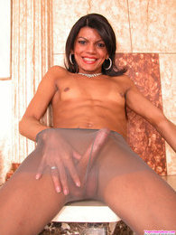 Spicy shemale playing with her hard-on till jazzing on her grey pantyhose pictures at find-best-lesbians.com