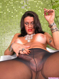 Naughty tranny spreading her pantyhosed legs wide to show her cock close-up pictures at freekilosex.com
