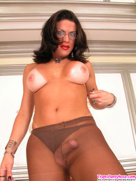 Busty shemale in glasses blowing a load right on her control top pantyhose pictures at find-best-lingerie.com