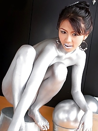 Naoimi Chatee painted up as a nude silver statue pictures at find-best-panties.com