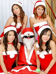 Santa Claus enjoying his harem of Thai toy helpers pictures