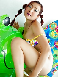 Hot bodied bikini bandit Iko Yeung in braids pictures at freekiloclips.com