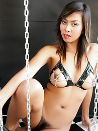 Holly You with her chains leather and glass dildo pictures at sgirls.net